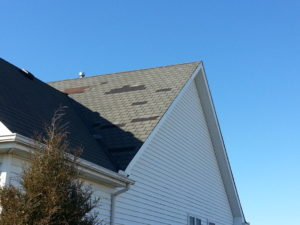 Many shingles were blown off this roof, despite having a higher wind resistance.