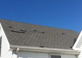These shingles were not installed properly, allowing them to blow off easily.