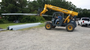 On this job, we had to remove and install the metal panels, and then install the EPDM rubber roof in Moyock.